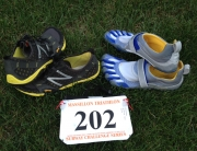 Lee Trains in the Bikila FiveFingers and races in the NB Minimus Trail shoes.