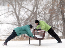 Ted Rhodes, Calgary Herald  CALGARY, AB,; NOVEMBER 30, 2011  --  Kitty Jones, left, and Marsha Fehr do pushups on a park bench in the snow, part of their morning workout ritual in St. Andrews Heights NW Wednesday morning November 29, 2011. (Ted Rhodes/Calgary Herald) For City story by No Reporter Assigned. Trax # NA